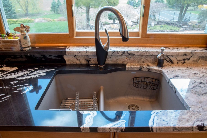 granite-copacabana-waterfall-edge-blanco-diamond-sink-countertops-4
