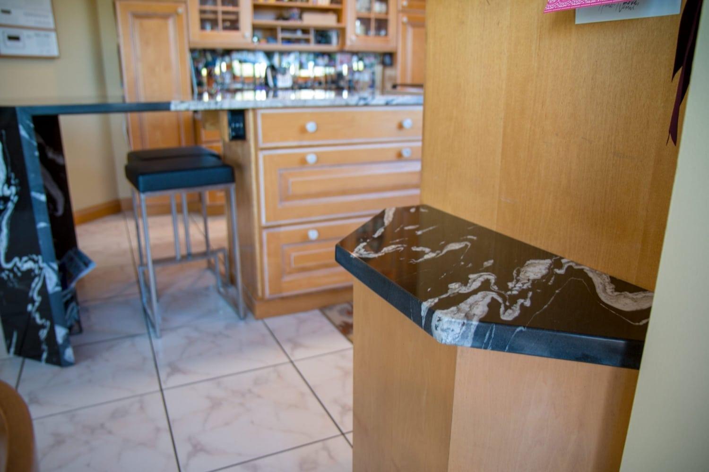 granite-copacabana-waterfall-edge-blanco-diamond-sink-countertops-9